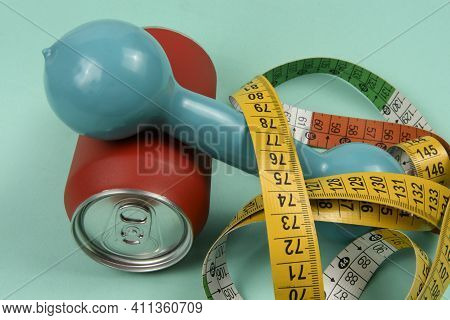 Red Aluminum Drink Can With Colorful Measuring Tape Symbolizing Person Wanting To Lose Weight G