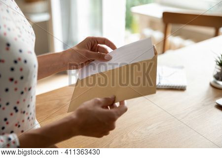 Female Hands Put Letter In Envelop Before Send By Mail