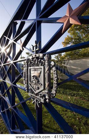 ANNAPOLIS, MD - OCT 21: The USNA coat-of-arms on the entrance gates to the US Naval Academy in downtown Annapolis on October 21, 2012 in Annapolis, Maryland. The campus was founded in 1845.