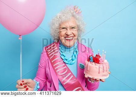Portrait Of Positive Grey Haired Woman Celebrates 102nd Birthday Gets Congratulations And Present Ho