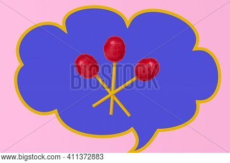 Lollipops On A Creative Background. Three Red Lollipops. Sweet Lollipops On A Bright Background.
