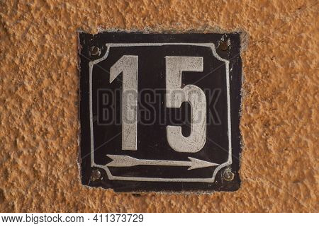 Weathered Grunge Square Metal Enamelled Plate Of Number Of Street Address With Number 15