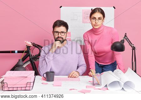 Busy Woman And Man Work In Team For Planning Discuss Ideas Of Productive Strategy Sit At Office Desk