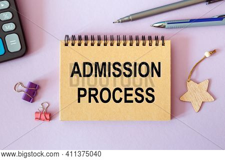 Admission Process - Written On A Notepad On An Office Desk With Office Accessories.