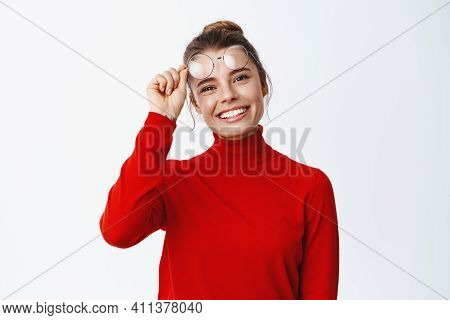 Portrait Of Happy Beautiful Woman In Red Sweater, Takes-off Glasses And Smiling Cheerful At Camera,