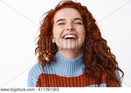 Candid And Real People. Happy Smiling Redhead Woman With Curly Natural Hair And Pale Skin, Laughing