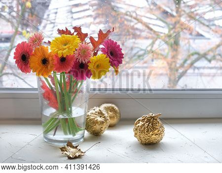 Bunch Of Pink, Magenta, Coral And Yellow Gerbera Flowers On A Window Board. Gilded Metallic Gold Lea