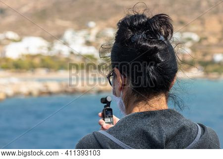 Ferry On Board, Cyclades Archipelago, Greece - 26 September 2020: Woman With Small Camera On Board T