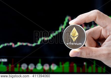 Silver Ethereum (eth) Cryptocurrency Coin With Candle Graph Background, Crypto Is Digital Money With