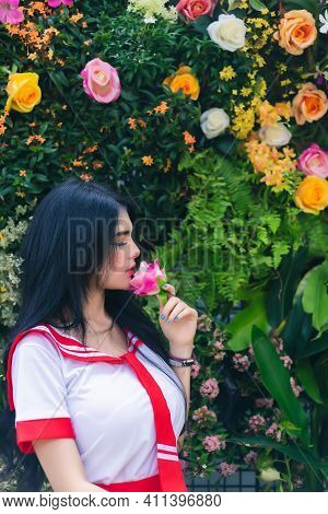 Beauty Woman Holding Flower And Get Nice Smell From Flower In Garden Charming Beautiful Girl Get Rel
