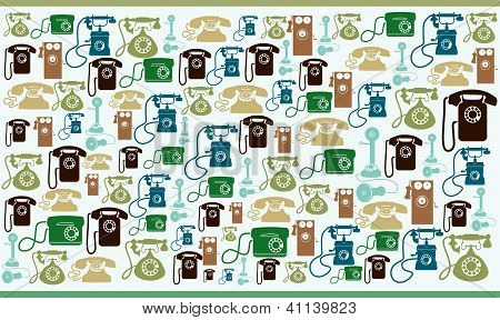 Various funny colourfull vintage old telephones on beige background