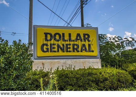 Snellville, Ga / Usa - 07 20 20: Dollar General Road Sign With Green Foliage, Power Lines And Poles