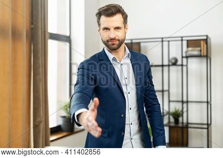 Confident Businessman Dressed In Suit, Handshake For Teamwork Of Business Merger And Acquisition, Su