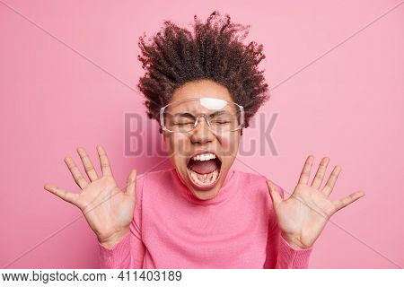 Super Excited Emotional Afro American Woman Goes Carazy And Screams With Wide Opened Mouth Keeps Pal