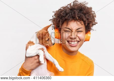 Positive Young Afro American Female Enjoys Cool Company Of Favorite Dog Happy To Get Small Pedigree