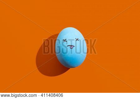 Egg Face. Teas Provoke. Food Decor. Character Drawing. Conceptual Art. Blue Figure With Painted Tric