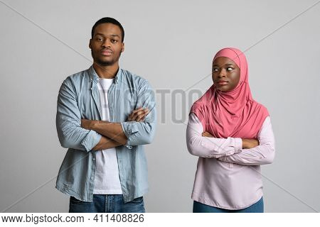 Frustrated Young Black Man And Angry Woman In Hijab Thinking About Breaking Up After Fight, Grey Stu