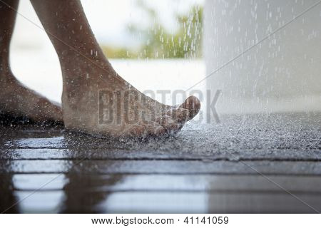 Low section of a woman taking shower