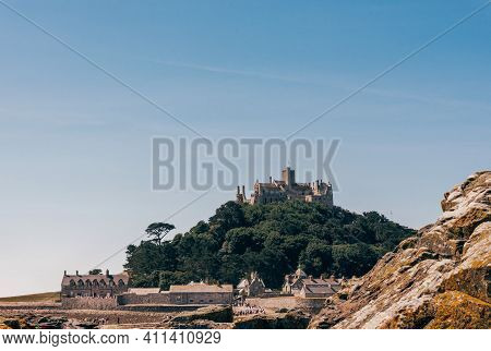 St Michaels Mount In Cornwall Britain. At Low Tide, The Island Can Be Reach By Foot From Marazion To