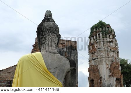 Back Of Old Ruins Buddha Yellow Cloth Cover On Buddha Shoulder ,thai Histry And Architecture In Wat
