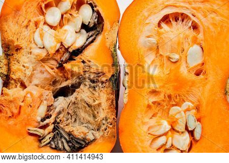 A Pumpkin Cut In Half, Left Half Is Rotten, Right Half - Good Quality, On A White Background.