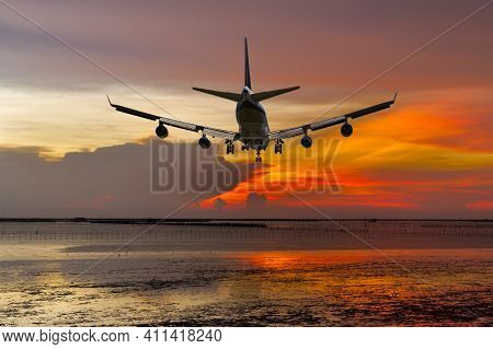 Rear View Commercial Passenger Aircraft Or Cargo Transportation Airplane Fly Over Coast Of Sea After