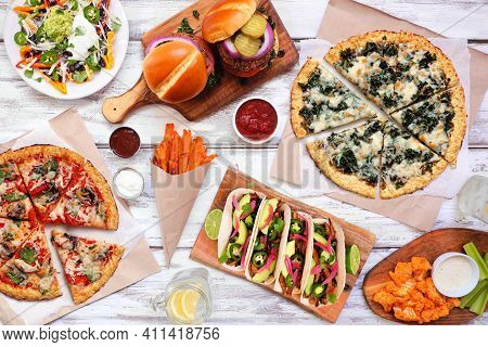 Healthy Plant Based Fast Food Table Scene. Above View On A White Wood Background. Cauliflower Crust