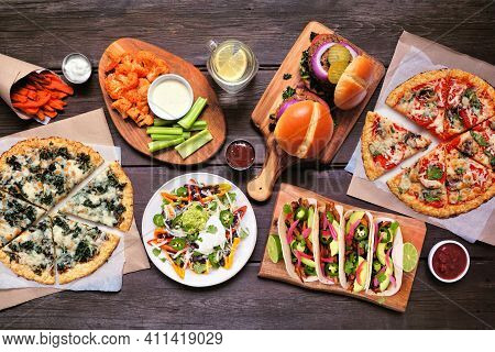 Healthy Plant Based Fast Food Table Scene. Top Down View On A Wood Background. Cauliflower Crust Piz