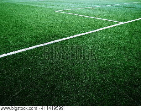 The Marking Of The Football Field On The Green Grass. White Lines No More Than 12 Cm Or 5 Inches Wid