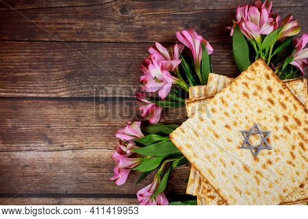 Top View Of Matzah And Pink Flowers. Passover Jewish Holiday.