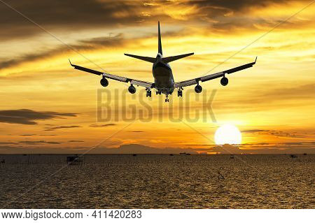 Rear Image Commercial Passenger Aircraft Or Cargo Transportation Airplane Fly Over Coast Of Sea Afte