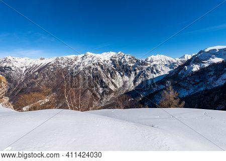 Snow Capped Mountains In Winter Of The Monte Carega, Called The Small Dolomites Seen From The Altopi