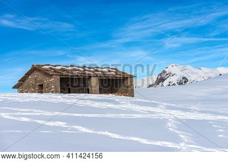 Old Stone Cow Shed On The Lessinia Plateau (altopiano Della Lessinia) Regional Natural Park, In Wint