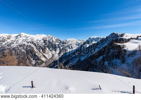 Mountain Range Of The Monte Carega In Winter With Snow, Also Called The Small Dolomites (piccole Dol