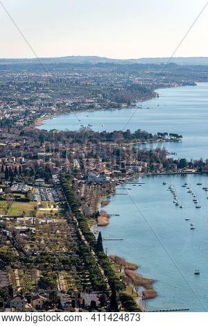 Aerial View Of The Lake Garda (lago Di Garda) With The Small Villages Of Bardolino, Cisano And Lazis