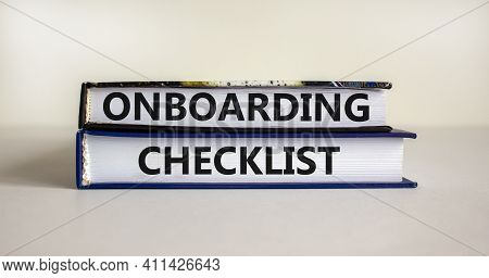 Onboarding Checklist Symbol. Books With Words 'onboarding Checklist' On Beautiful White Background.