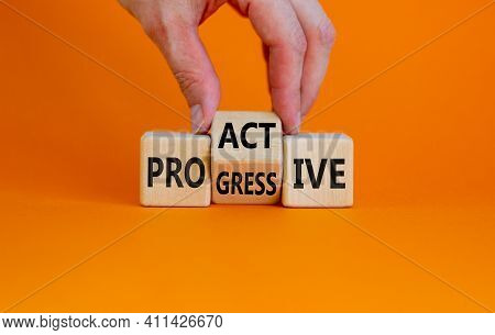 Proactive And Progressive Symbol. Businessman Turns Cubes And Changes The Word 'progressive' To 'pro
