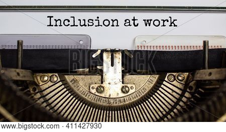 Inclusion At Work And Belonging Symbol. Concept Words'inclusion At Work' Typed On Retro Typewriter.
