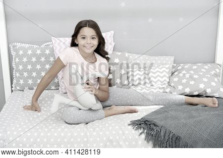 Girl Long Curly Hair Enjoy Evening Time With Favorite Toy. Kid Sit Bed And Play Bunny Toy Modern Bed