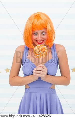 Fashion Girl With Orange Hair Having Fun. Happy Pinup Model With Lollipop In Hand. Cool Girl With Lo