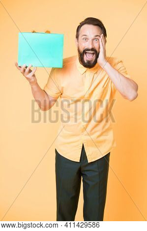 What A Surprise. Man Mature Bearded Guy Surprised Face Holds Gift Box. Man Got Unexpectable Gift. Gu