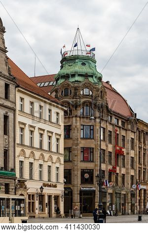 Wroclaw, Poland - May 03 2020: Old Tenement Building With Polish Flags And European Union Flags On T