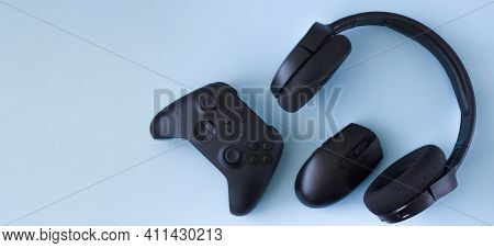 Gamer Flat Lay. Gaming Accessories On Blue Background With Copy Space.gamer Gadgets.
