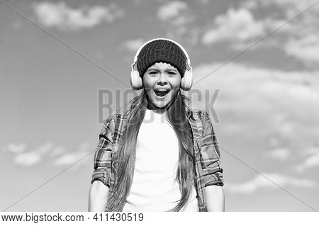 Audio Equipment Which Brings Out The Best In Music. Happy Child Sing To Music Playing In Headphones