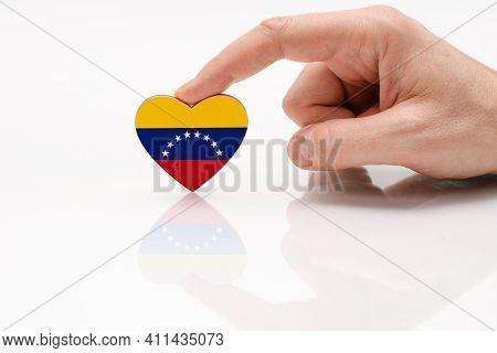 Venezuela Flag. Love And Respect Venezuela. A Man's Hand Holds A Heart In The Shape Of The Venezuela