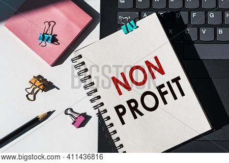 Notebook With Tools And Notes About Non Profit Lies On Laptop.
