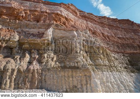 Working Wall Or Board Of Industrial Quarry. Geological Cut Contains Layers Of Different Kind Of Eart