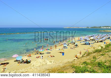 Paphos, Cyprus, Greece - June 8, 2018 : Tourists On Paphos Beach A Tourist Resort In Cyprus