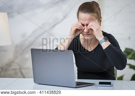 Fatigued Tired Sleepy Young Woman Is Rubbing Her Eyes, Suffering From Eyestrain In Front Of A Pc Scr