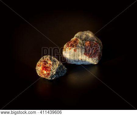 Garnet Stone Crystal Inside Granite And Quartzite Rock Isolated On Black. Found In Kem, Karelia, Rus